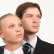 Young business woman and businessman look upward — Stock Photo