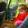 Little girl sit in car in park — Stock Photo