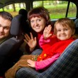 Married couple and  little girl  Greeting to wave hands in car i — Foto de Stock