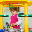 Little girl washes ware — Stock Photo