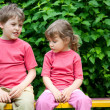 The boy and the girl in park — Stockfoto