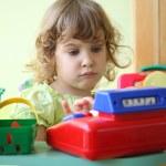 Little girl plays shop — Stock Photo