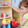 Stock Photo: Young girl thinking on kitchen