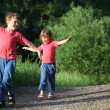 Boy and girl make gymnastic in park — Stock Photo