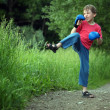 Boy-boxer trains in park — Stock Photo