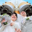 Stock Photo: Space rocket over fiance and bride