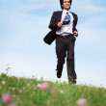 Businessman on grass — Stock Photo #7427884