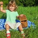 Pretty Little Girl keeps in hand sweet cherries in garden — Stock Photo #7427975