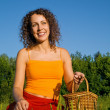 Young Women with basket on glade — Stock Photo