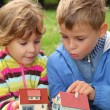 Children with toy small houses in hands outdoor — Stock Photo #7428123