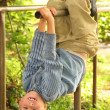 Boy hangs on bars headfirst — Stock Photo