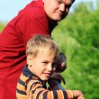 Man and boy outdoor in summer - Stock Photo