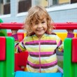 Little smiling child playing outdoors — Stock Photo