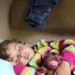 Little girl sleeps in train with puppet — Stock Photo #7428443