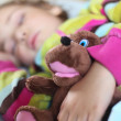 Little girl sleeps in train with puppet — Stock Photo #7428444