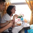 Family eats in train - Stock Photo