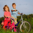 Royalty-Free Stock Photo: Young smiling bikers rest outdoors