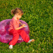 Stock Photo: Young writing girl sits in inflatable armchair