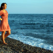 Stock Photo: Young womstands ashore of sea