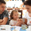 Stock Photo: Family in cafe