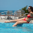 Girl sits at pool — Stockfoto #7428582