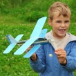 Boy with toy airplane in hands outdoor — Stock Photo #7428668