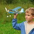 Boy with toy airplane in hands outdoor — Stock Photo #7428670