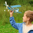 Boy with toy airplane in hands outdoor — Stock Photo