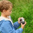 Boy with photo cameroutdoor — Stock Photo #7428686
