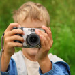 Boy photographs outdoor — Stock Photo #7428688