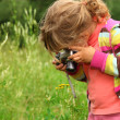 Little girl  photographs outdoor — Stock Photo