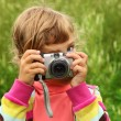 Little girl photographs outdoor — Stock Photo #7428751