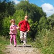 Stock Photo: Two children run on path in summer