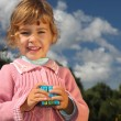 Little girl with magic cube outdoor in summer - Stock Photo