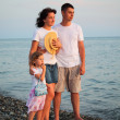 Family on beach — Stock Photo #7428882