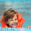 Little girl in inflatable waistcoat in pool — Stock Photo #7429192