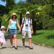 Family walk on road in Sochi arboretum — Stock Photo