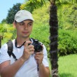 Stock Photo: Photographer in sochi arboretum