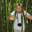 Photographer in bamboo grove in  Sochi arboretum — Stock Photo