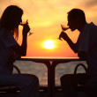 Silhouettes on sunset — Stock Photo #7429357