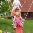 Three children on teetering-board — Stock Photo