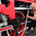 Athlete checks locomotive condition — Stock Photo #7429399