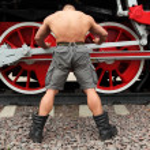 Bodybuilder and train — Stock Photo #7429401