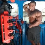 Athlete in locomotive cabin full body — Stock Photo #7429409
