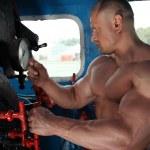 Athlete in locomotive cabin — Stock Photo #7429411