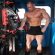 Athlete in locomotive cabin full body - Stock Photo