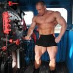 Athlete in locomotive cabin full body — Stock Photo #7429418