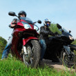 Two motorcyclists standing on country road, bottom view — Stock Photo #7429460