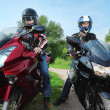Two motorcyclists standing on country road — Stock Photo #7429463
