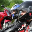 Closeup of two motorcyclists sitting on country road near bikes — Stock Photo
